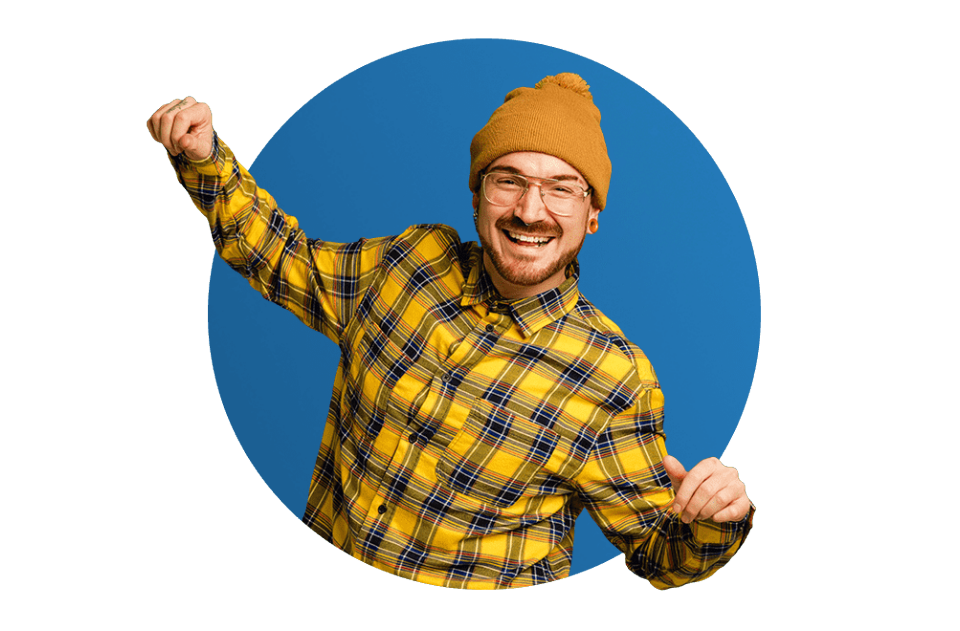 Man in a yellow shirt and beanie dancing